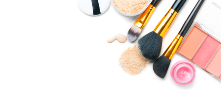 Cosmetic liquid foundation or cream, loose face powder, various brushes for apply makeup. Make up concealer smear and powder isolated on a white background. Products for professional face skin makeup 免版税图像