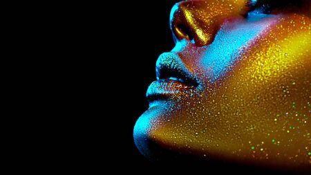 Fashion model woman skin face in bright sparkles, colorful neon lights, beautiful sexy girl lips, mouth. 写真素材