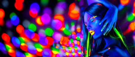 Sexy girl dancing in neon lights. Fashion model woman with fluorescent makeup posing in UV on bright