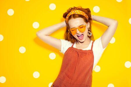 Fashion model girl over yellow polka dots
