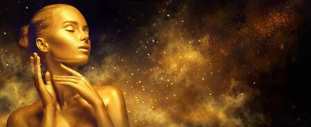 Beauty woman with golden skin. Reklamní fotografie