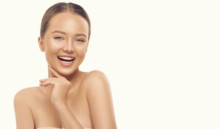 Portrait of beauty smiling young woman on white background. Beautiful spa girl with perfect fresh skin proposing a product. Cleansing, skincare concept