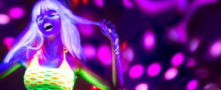 Neon Woman dancing. Fashion model woman in neon light, portrait of beautiful model with fluorescent make-up, Art design of female disco dancer posing in UV, colorful make up. On bright background 写真素材 - 129813495