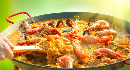Paella. Traditional spanish food, seafood paella in the fry pan with mussels, king prawns, langoustine and squids