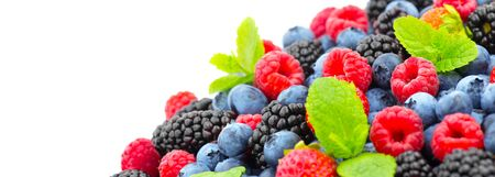 Berries. Various colorful berries background. Strawberry, raspberry, blackberry, blueberry closeup over white. Healthy eating