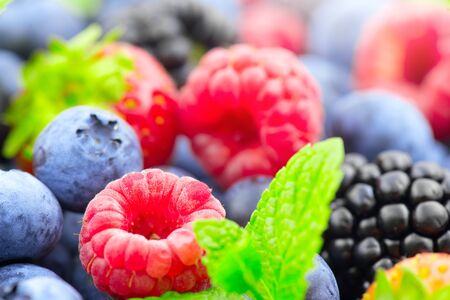 Berries. Various colorful berries background. Strawberry, raspberry, blackberry, blueberry closeup. Healthy eating
