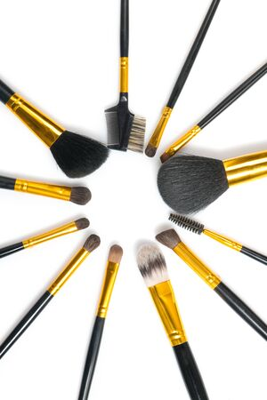 Make-up Brushes set over white background. Various Professional makeup brush on white in studio. Make up artist tools. Flatlay, top view. Vertical image Stock fotó