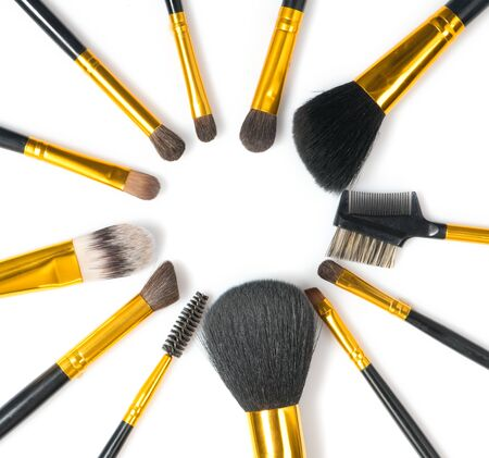Make-up Brushes set over white background. Various Professional makeup brush on white in studio. Make up artist tools. Flatlay, top view, flatlay backdrop
