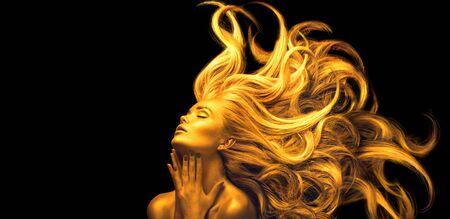 Gold Woman. Beauty fashion model girl with Golden make up, Long hair on black