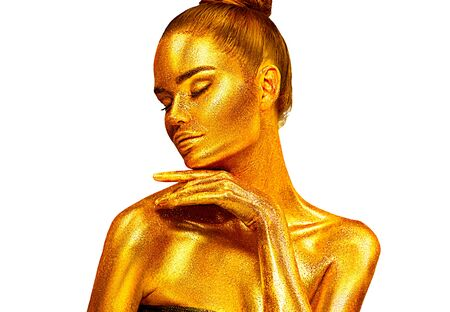 Fashion art Golden skin Woman face Beauty gold metallic body portrait isolated on white background. Christmas Model girl with holiday golden Glamour shiny makeup. Gold jewellery, jewelry, accessories
