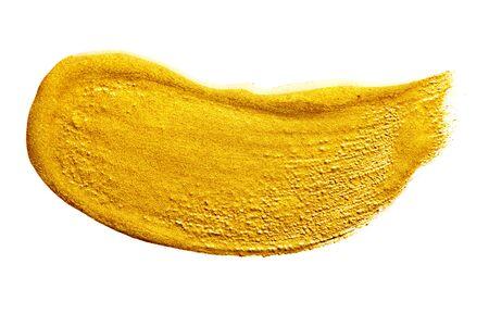 Gold paint Brush stroke isolated on white Imagens