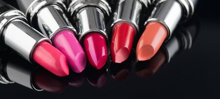 Lipstick. Fashion Colorful Lipsticks over black background. Lipstick tints palette, Professional Makeup and Beauty. Beautiful Make-up concept. Lipgloss. Lipsticks closeup Zdjęcie Seryjne