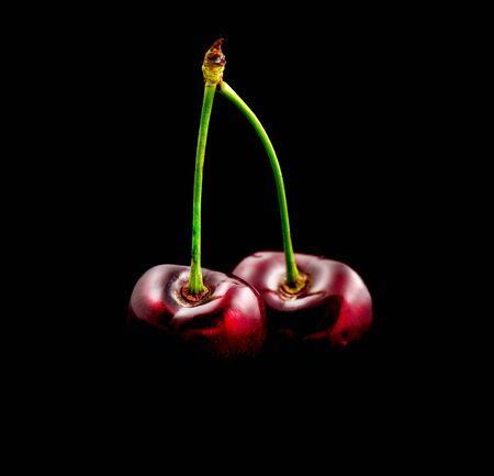 Fresh ripe Cherry close-up isolated on black Zdjęcie Seryjne
