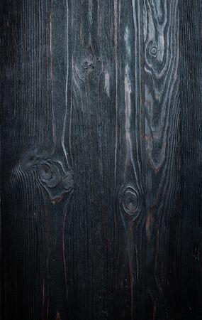 Black wood vintage background. Black Wooden backdrop texture, detail. Beautiful dark wood design. Carpentry. Planks