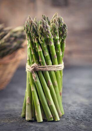 Fresh raw organic green Asparagus sprouts closeup.
