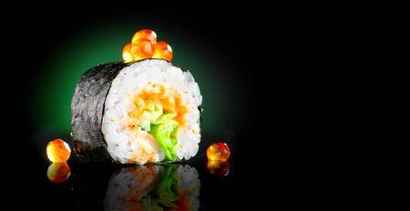 Sushi roll Japanese food over black Zdjęcie Seryjne