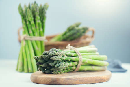 Asparagus. Fresh raw organic green Asparagus sprouts closeup. Healthy vegetarian food. Raw vegetables, market. Healthy vegetarian food cooking. Healthy eating concept, diet