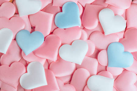 Valentine's Day Hearts Background. Holiday Abstract Valentine Background with pink, white and blue pastel color satin Hearts. Hearts backdrop. Love concept, wedding. Flat lay Standard-Bild