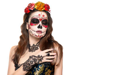 Sugar skull makeup. Halloween party, traditional Mexican carnival, Santa Muerte. Beautiful young woman costume, painted face. Model girl isolated on white background, make-up. Calavera  Catrina