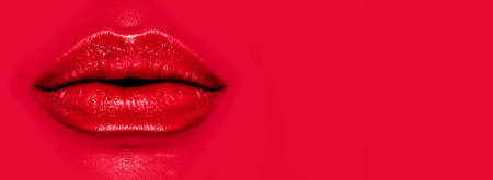 Beautiful young woman's lips closeup, on red background. Plastic surgery, fillers, injection. Part of the model girl face, youth concept. Perfect mouth, make-up. Health care. Art design.