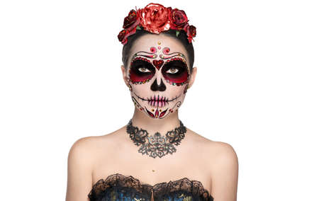 Sugar skull makeup. Halloween party make-up, traditional Mexican carnival, Santa Muerte. Beautiful young woman costume, painted face. Model girl isolated on white background.
