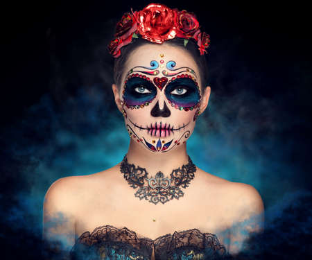Sugar skull makeup. Halloween party, traditional Mexican carnival, Santa Muerte. Beautiful young woman costume, painted face