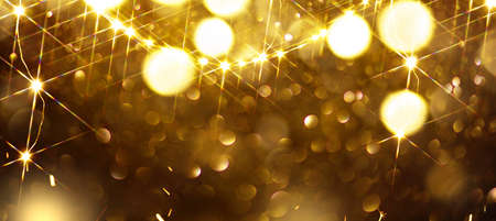 Christmas glowing golden background. Golden Holiday Abstract Glitter Defocused Backdrop With Blinking Stars and garlands. Standard-Bild