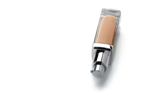 Foundation face make-up sample. One glass transparent bottle of cosmetic liquid foundation or bb cream, Natural Light beige colour. Make up smear isolated on a white background Standard-Bild