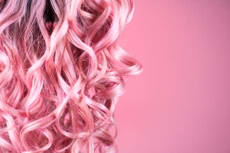 Hair. Beautiful healthy long curly dyed pink color hair close-up texture. Fashion trendy Dyed wavy hair background, coloring, extensions, cure, treatment concept. Haircare Standard-Bild