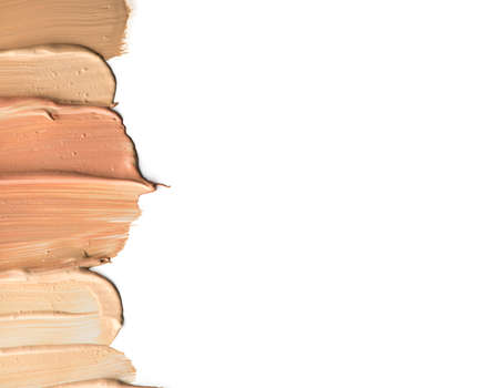 Set of cosmetic liquid foundation or cream in different colour smudge smear strokes. Stock Photo