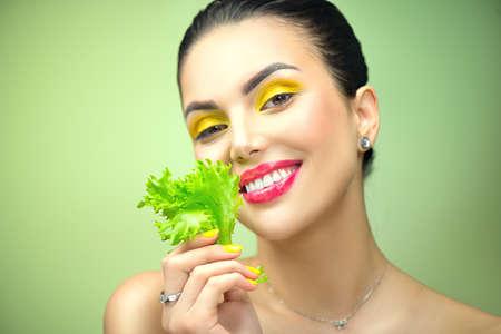 Healthy eating, diet. Beautiful healthy girl eating raw vegan food and smiling.