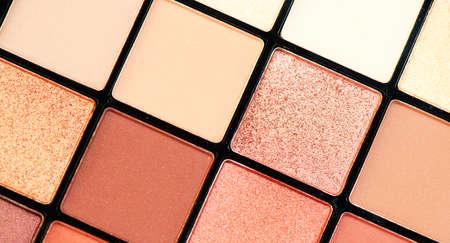 Makeup palette set. Professional multicolor eyeshadow palette. Make up. Professional multicolor eye shadow make-up palette background, close-up. Various Colorful bright eye shadows backdrop. Stock Photo