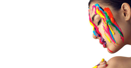 Fashion Model Girl colorful face paint. Beauty art portrait of beautiful woman with flowing liquid paint, abstract makeup. Vivid paint make-up, bright colors. Multicolor creative art, on white
