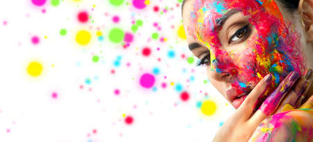 Fashion Model Girl colorful face paint. Beauty fashion art portrait, beautiful woman with painting smears, abstract makeup. Vivid paint make-up, bright colors. Multicolor creative make-up. Painter Stock Photo
