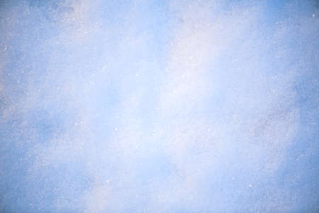 Snow background, winter backdrop. Christmas nature. White cold waves of snow sparkles in the sun. Xmas abstract background