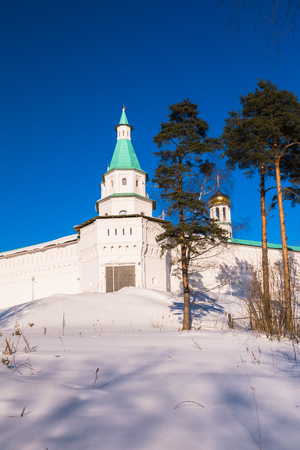 The fortress walls with towers around the New Jerusalem Monastery of the 17th century. Istra, Moscow suburbs, Russia. Stock Photo