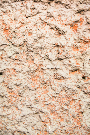 Rough durable textured stucco wall coating. Abstract patchy background.