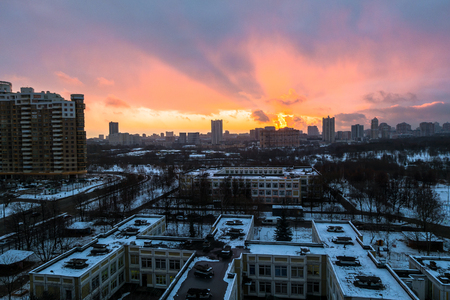 Winter fiery dawn over the city. Panoramic view of a modern residential area and a delightful sky in the background. Stok Fotoğraf