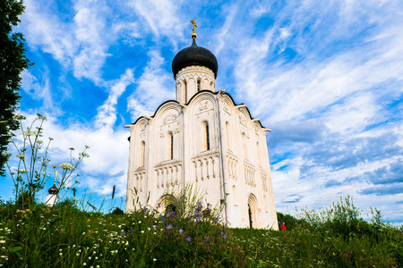 Amazing blue sky over the Russian ancient shrine. Orthodox Church of the Intercession on the Nerl River