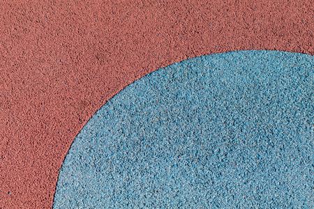 floor covering: Rubber play ground floor surface covering, colorful blue and red, curved shapes
