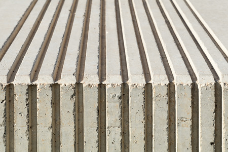 flute structure: close of of concrete bench, ridges with chipped edges Stock Photo