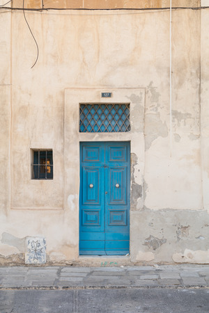 creed: Traditional Maltese blue wooden house door shot straight-on in Valletta, Malta, Europe. Used in the 2015 filming of the Assassins Creed movie.