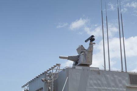 deck cannon: CIWS, close in weapon system, mounted on Dutch Naval Frigate, under clear blue sunny skies,  Malta, June 2016