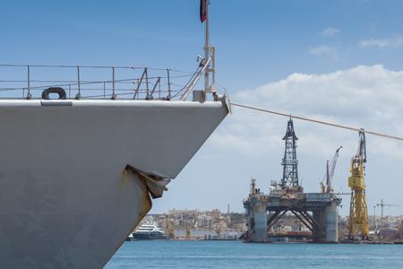 battleship: Battleship gray prow of Doorman-class frigate F831 docked in the shipyards of the Grand Harbor of Malta, June 2016