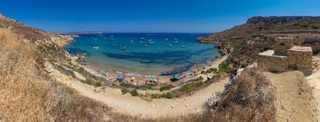 Ultra high resolution panorama of beautiful azure blue water of Selmun beach in the summer time, in Maltese Imgiebah Bay, Il-Mellieha, Malta,