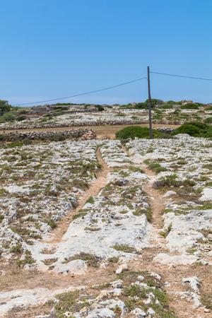 Mysterious ancient cart ruts at Misrah Ghar il-Kbir aka Clapham Junction, a prehistoric site near the Dingli Cliffs, Siggiewi, Malta Stock Photo