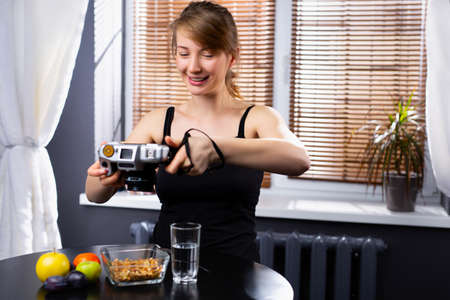 Young hipster caucasian blogger take photo of food, plate, healthy recipe, lunch meal, breakfast share to story in social media at restaurant, home. Vintage photo camera, blogging . High quality photo Imagens