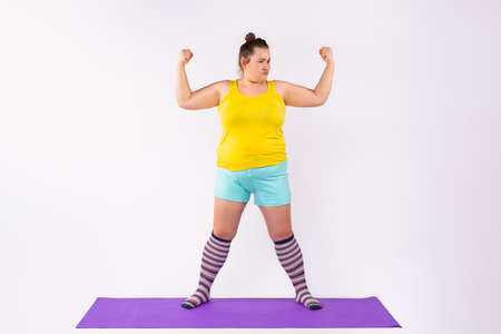 Caucasian curvy women in bright clothes isolated on studio background. The concept of young people and obesity.