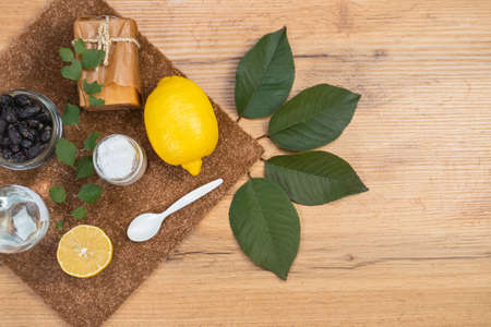 Natural homemade skincare ingredients for peeling mask. Green home cleaning. Baking soda, lemon, natural soap, olive oil, vinegar. Organic body care, still life, background with empty side