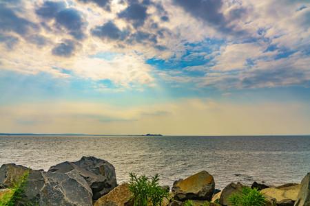 Rock beach of ocean and battleship Stock Photo